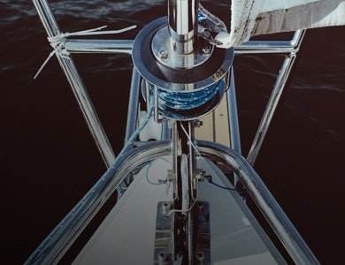 Mast of a sailboat wedding venue showing the bow of the yacht and the ocean.